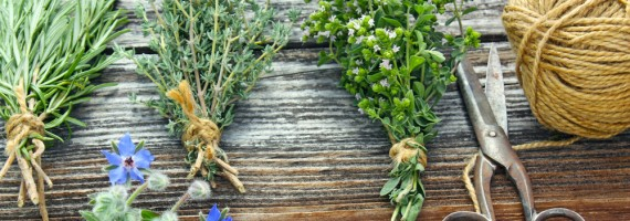posy of fresh herbs with scissors and string